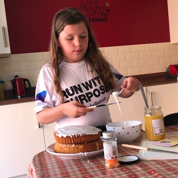 Young girl baking a cake