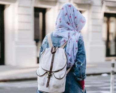 Women with her back to the camera. She has a backpack on her back.