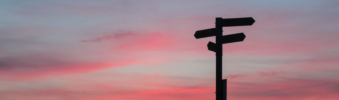 A signpost in the sunset