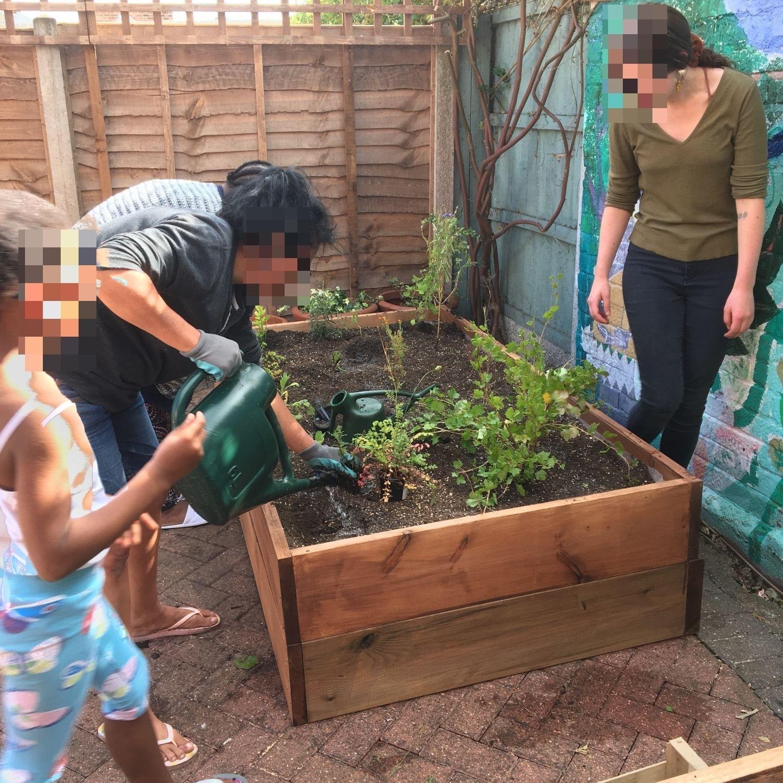 Clients watering the garden